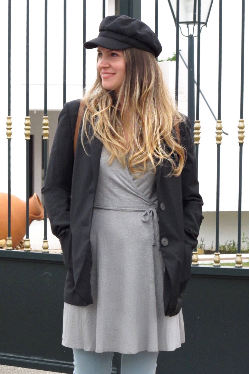 Bakerboy Hat. Fashion Blogger Girl by Style Blog Heartfelt Hunt. Girl with blond, loose curls wearing a bakerboy hat, blazer, jersey dress, destroyed jeans, Michael Kors backpack and lace-up ballet flats.