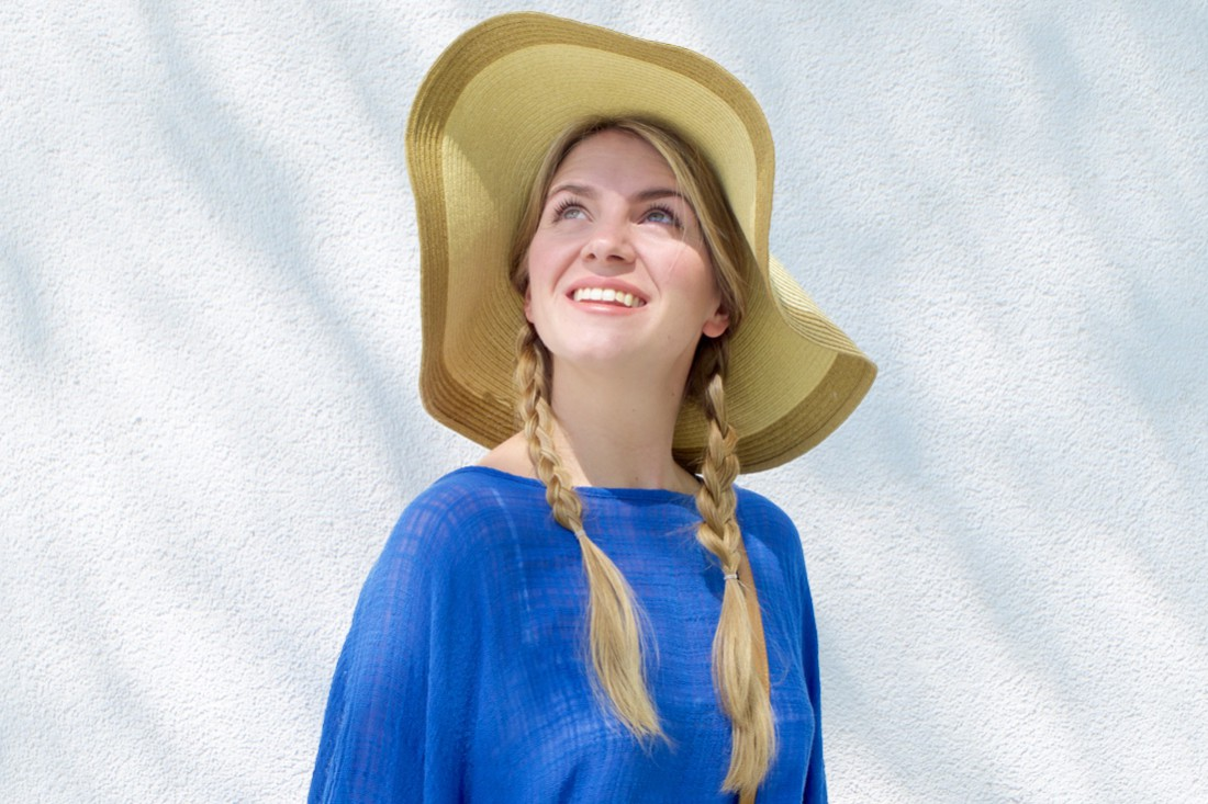 Blue Tassels. Fashion Blogger Girl by Style Blog Heartfelt Hunt. Girl with two braids wearing a top with blue tassels and a straw hat.