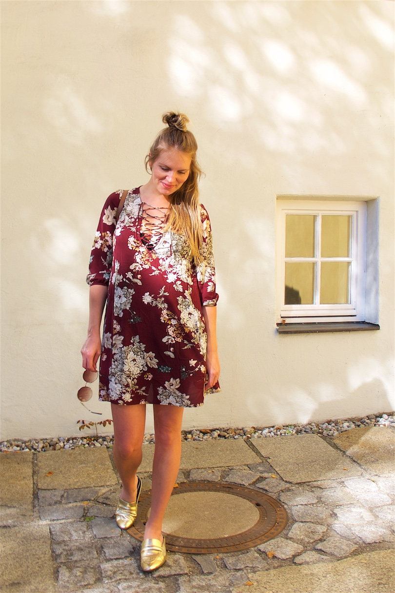 Burgundy Flower Dress. Fashion Blogger Girl by Style Blog Heartfelt Hunt. Girl with blond half-up half-down bun wearing a burgundy flower dress, round sunglasses, Michael Kors backpack and mules.