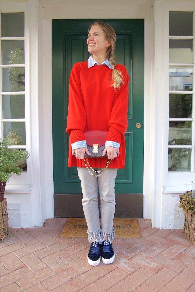 Cozy Red. Fashion and Style Blog Girl from Heartfelt Hunt. Girl with blonde dutch braid wearing a cozy red sweater, striped blouse, fringe jeans, Louis Vuitton bag and velvet sneakers.