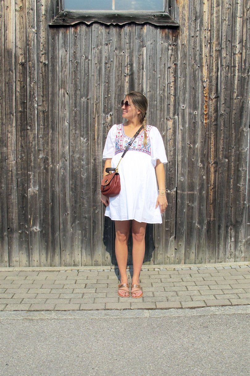Embroidered Dress. Fashion Blogger Girl by Style Blog Heartfelt Hunt. Girl with blond dutch braid wearing an embroidered dress, Michael Kors bag and metallic sandals.