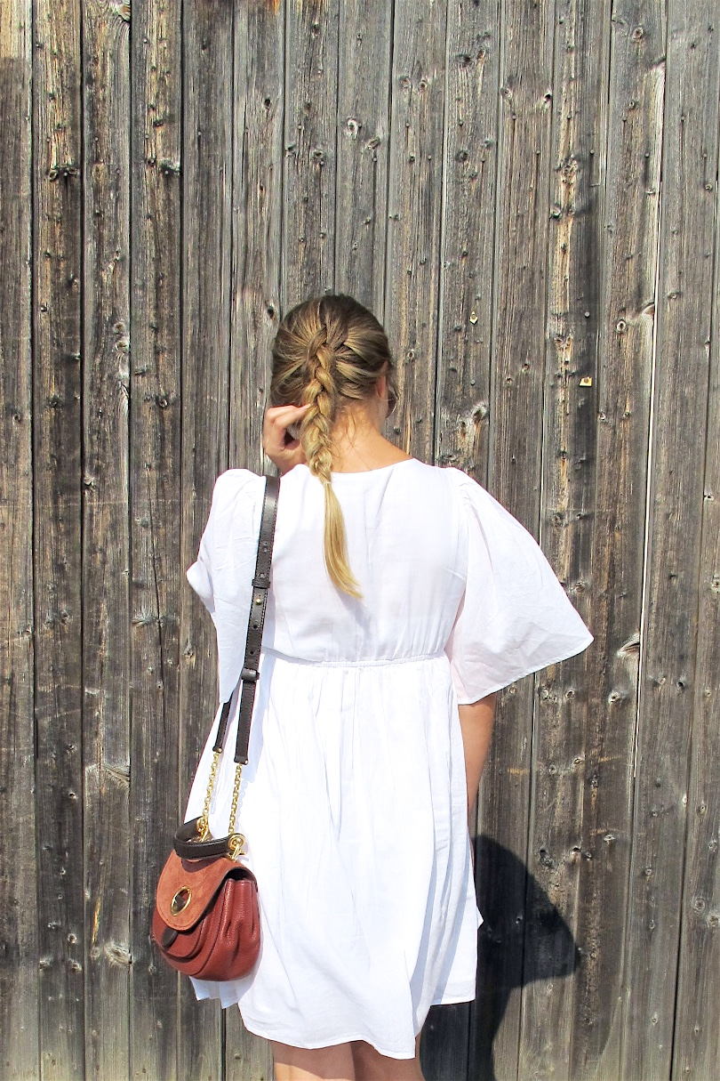 Embroidered Dress. Fashion and Style Blog Girl from Heartfelt Hunt. Girl with blonde dutch braid wearing an embroidered dress, Michael Kors bag and metallic sandals.