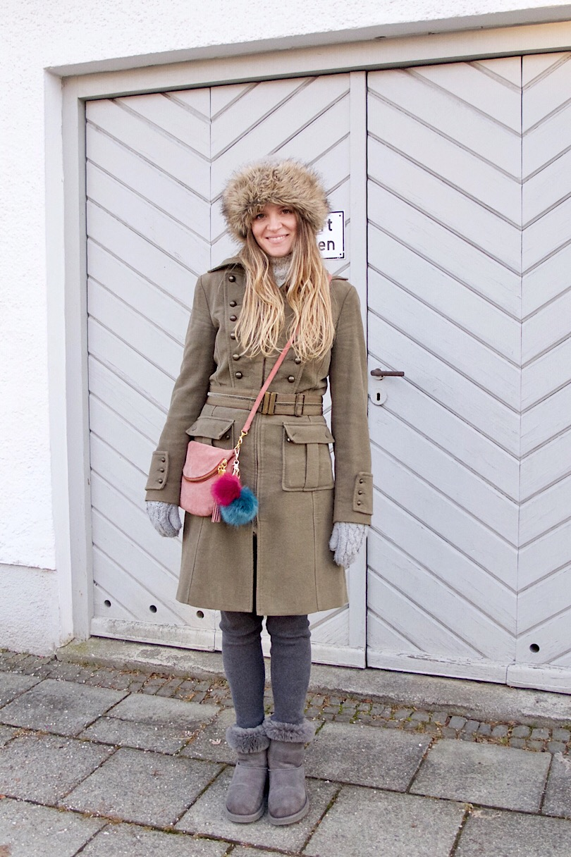 Faux Fur Hat. Fashion Blogger Girl by Style Blog Heartfelt Hunt. Girl with blond, long hair wearing a faux fur hat, coat, bag, pompoms and Ugg boots.
