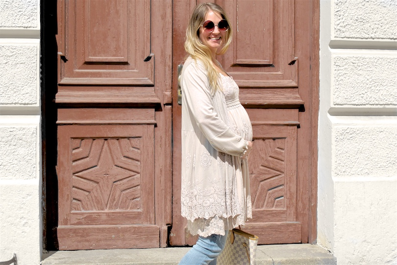 Maternity Jeans. Fashion Blogger Girl by Style Blog Heartfelt Hunt. Girl with blond, loose curls wearing some maternity jeans, lace dress, cardigan, Louis Vuitton bag and ankle boots.