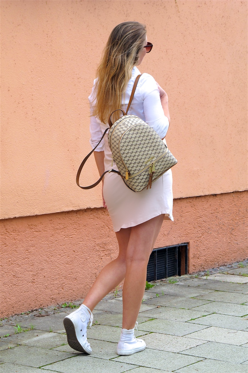 Michael Kors Backpack. Fashion and Style Blog Girl from Heartfelt Hunt. Girl with blonde, long hair wearing a Michael Kors backpack, jersey dress, white blouse, cat eye sunglasses and Converse sneakers.