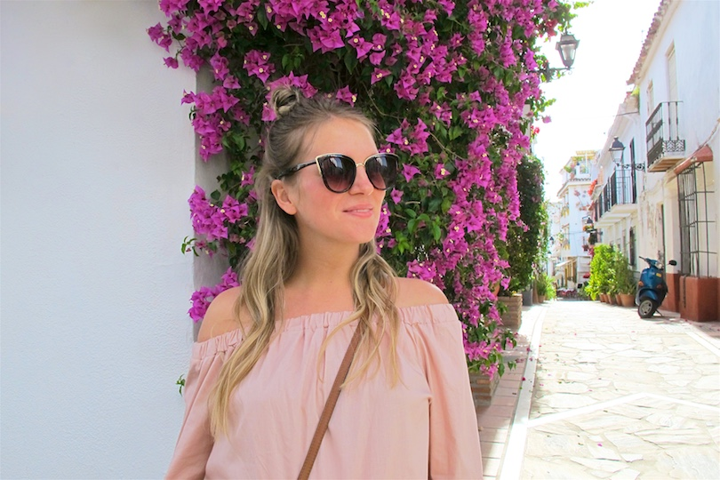 Nude Blouse With Ruffled Sleeves. Fashion Blogger Girl by Style Blog Heartfelt Hunt. Girl with blond half-up half-down bun wearing a nude off-shoulder blouse with ruffled sleeves, jeans, cat eye sunglasses, See by Chloé bag and lace up sandals.
