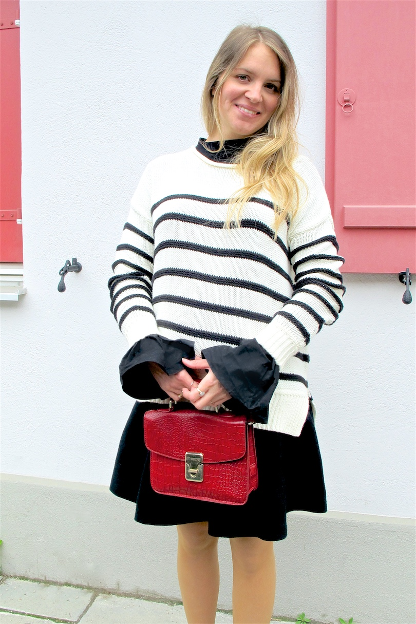 Red Bow Shoes. Fashion and Style Blog Girl from Heartfelt Hunt. Girl with blonde, loose curls wearing red bow shoes, striped sweater, top with trumpet sleeves, flared skirt and a red bag.