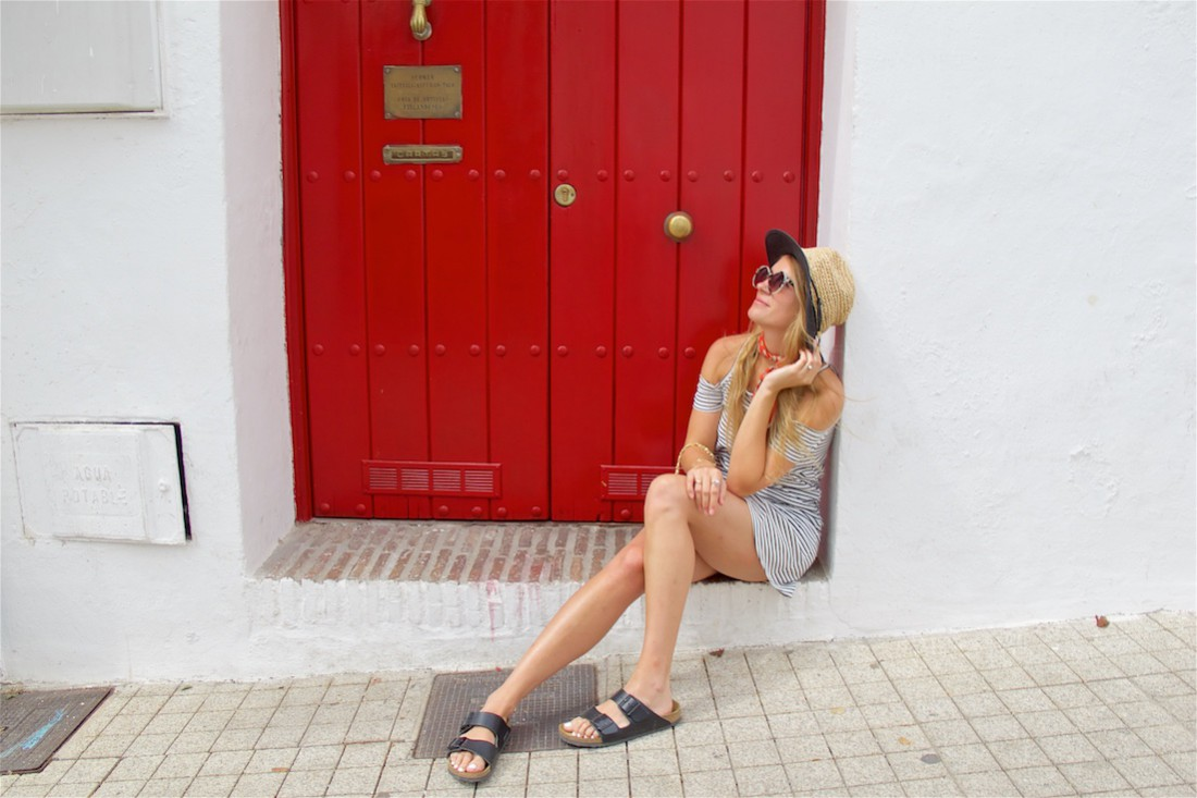 Red Summer Scarf. Fashion Blogger Girl by Style Blog Heartfelt Hunt. Girl with long, blond hair wearing a striped cold-shoulder dress, red summer scarf, straw hat, vintage Chanel bag, marbled sunglasses and Birkenstock sandals.