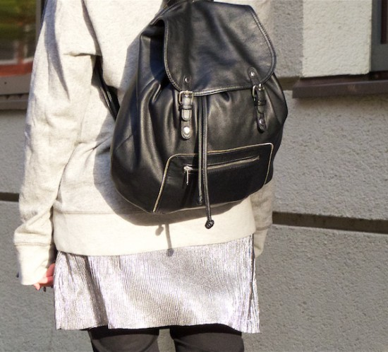 Silver Slip Dress. Fashion Blogger Girl by Style Blog Heartfelt Hunt. Girl with blond high messy bun wearing a silver slip dress, oversized sweater, jeans, backpack and burgundy brogues.