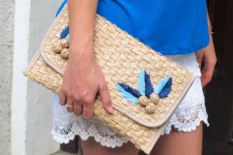 Straw Clutch. Fashion Blogger Girl by Style Blog Heartfelt Hunt. Girl with blond braided halo hairstyle wearing a straw clutch, blue top, lace skirt and fringe sandals.