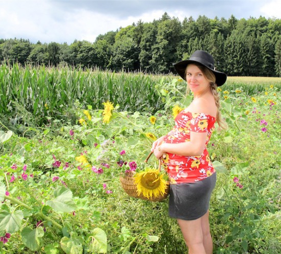 Sunflower Fields. Fashion Blogger Girl by Style Blog Heartfelt Hunt. Girl with blond side braid wearing a floral off-shoulder dress, skirt, floppy hat and boots.