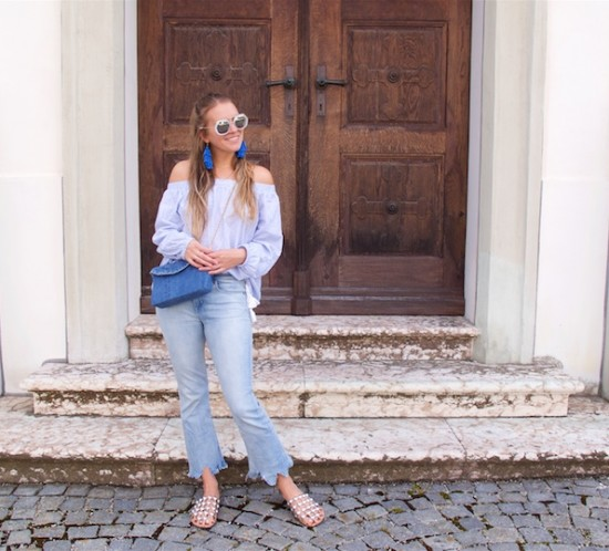 All Things Blue. Fashion Blogger Girl by Style Blog Heartfelt Hunt. Girl with blond half-up half-down hairstyle wearing a blue striped off shoulder blouse, blue destroyed jeans, blue diy denim bag, blue diy tassel earrings and studded sandals.