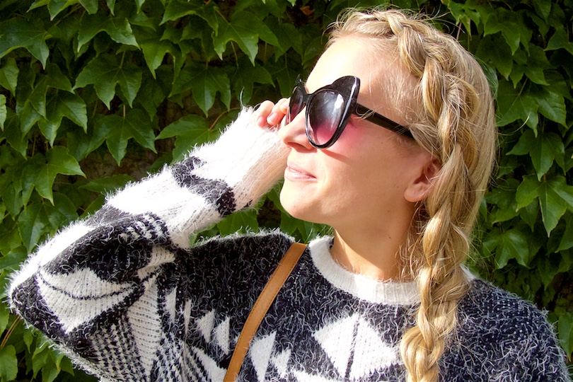Aztec Pattern. Fashion and Style Blog Girl from Heartfelt Hunt. Girl with blonde dutch side braid wearing an Aztec pattern sweater, cat eye sunglasses, tassel bag and over the knee boots.