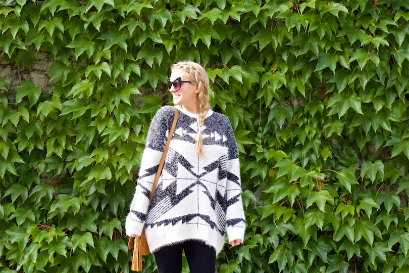 Aztec Pattern. Fashion Blogger Girl by Style Blog Heartfelt Hunt. Girl with blond dutch side braid wearing an Aztec pattern sweater, cat eye sunglasses, tassel bag and over the knee boots.