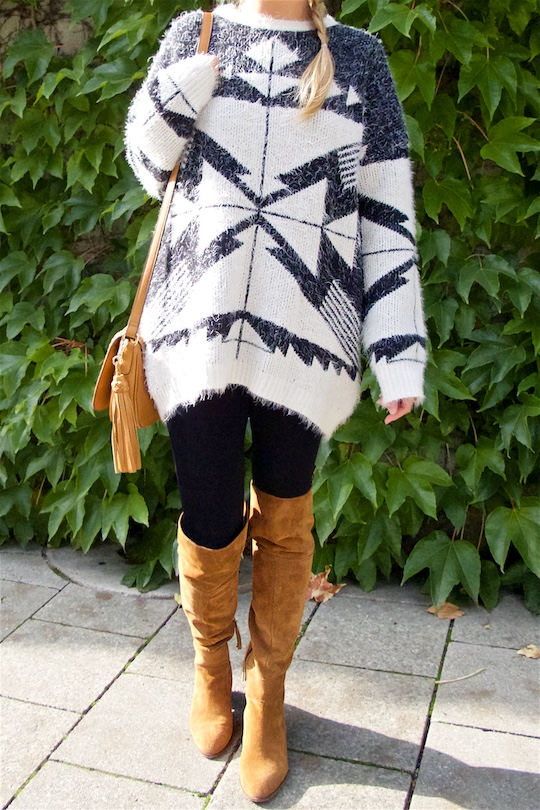 Aztec Pattern. Fashion Blogger Girl by Style Blog Heartfelt Hunt. Girl with blond dutch side braid wearing an Aztec pattern sweater, tassel bag and over the knee boots.