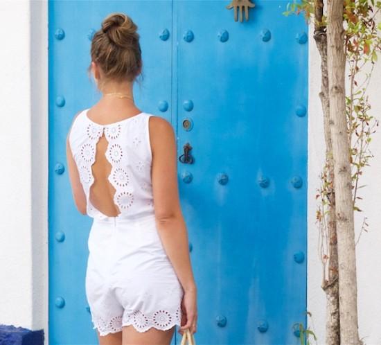 Backless Jumpsuit. Fashion Blogger Girl by Style Blog Heartfelt Hunt. Girl with blond high messy bun wearing a backless jumpsuit, round straw bag and striped bow shoes.