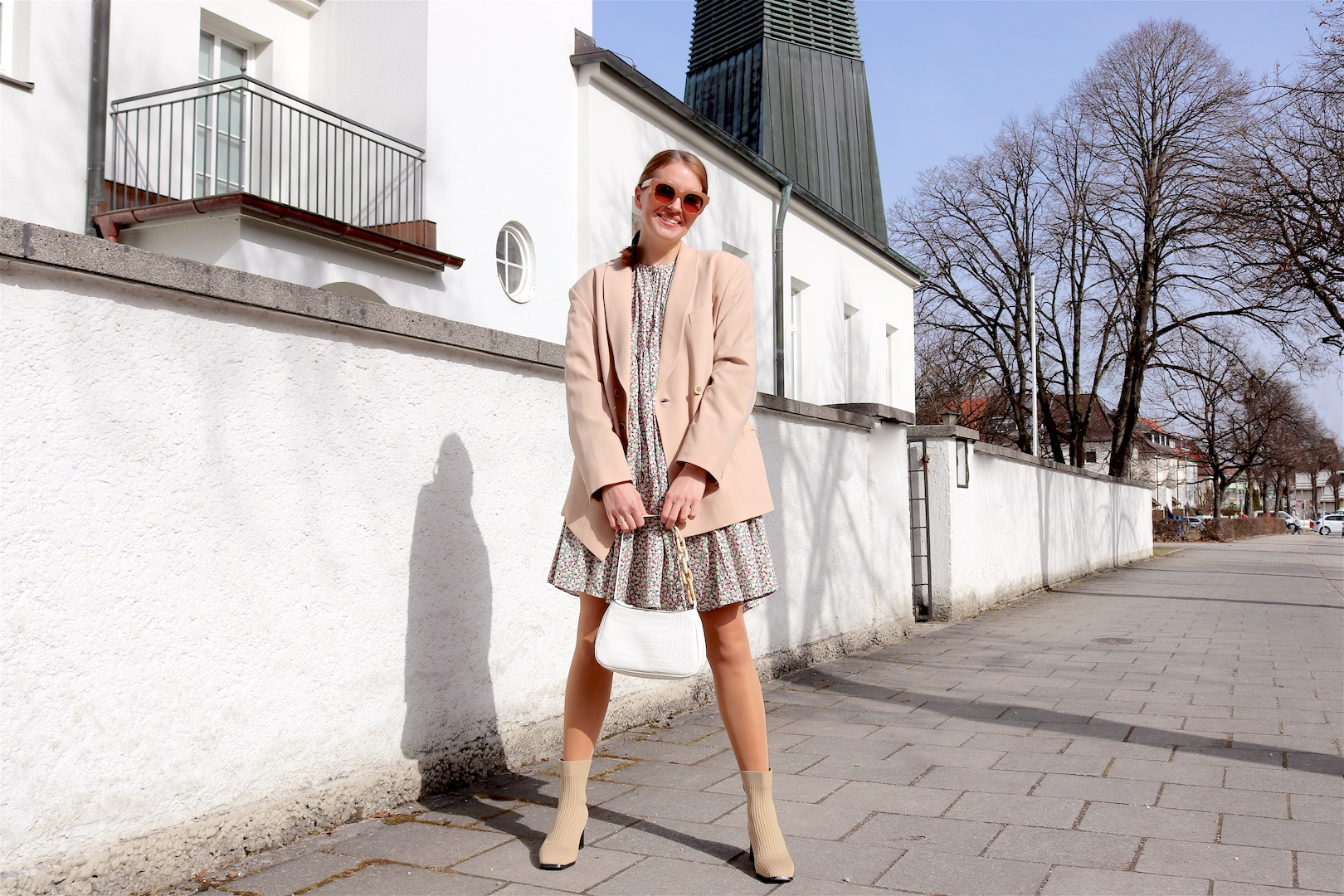 Beige Blazer. Fashion Blogger Girl by Style Blog Heartfelt Hunt. Girl with blond braid wearing a beige blazer, floral dress, white bag and sock boots.