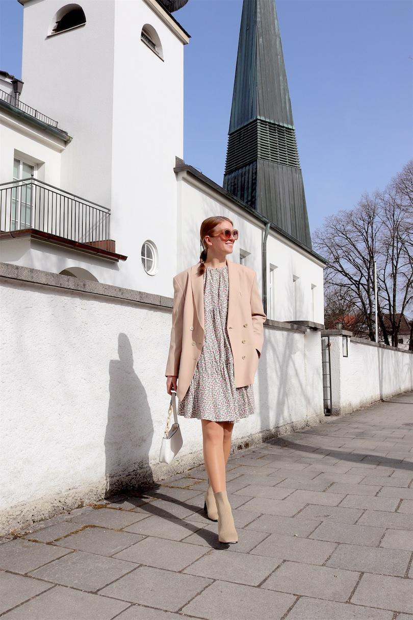 Beige Blazer. Fashion Blogger Girl by Style Blog Heartfelt Hunt. Girl with blond braid wearing a beige blazer, floral dress, white bag and sock boots.