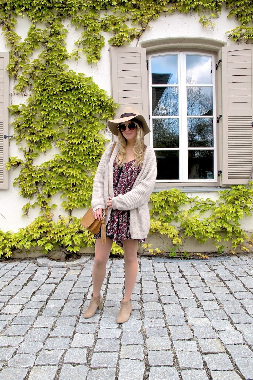 Beige Floral Dress. Fashion and Style Blog Girl from Heartfelt Hunt. Girl with blonde, loose curls wearing a beige cardigan, floral dress, floppy hat, tassel bag and beige boots.