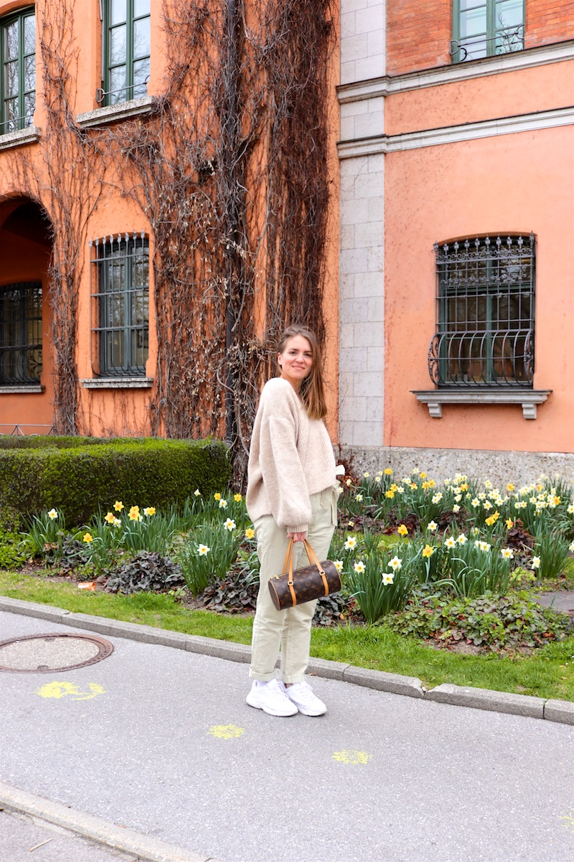 Beige Shades. Fashion Blogger Girl by Style Blog Heartfelt Hunt. Girl with blond hair wearing a beige sweater, beige paperbag pants, Louis Vuitton purse and white chunky sneakers.