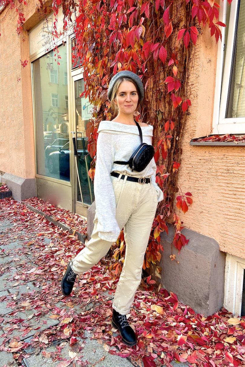 Belt Bag Love. Fashion and Style Blog Girl from Heartfelt Hunt. Girl with blonde, low bun wearing a belt bag, beret, off shoulder sweater, paperbag pants and combat boots.