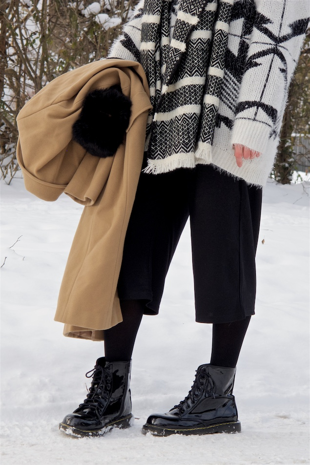 Black and White. Fashion and Style Blog Girl from Heartfelt Hunt. Girl with blonde half-up half-down bun wearing a black and white sweater, wool coat, culotte pants, black and white scarf and shiny boots.