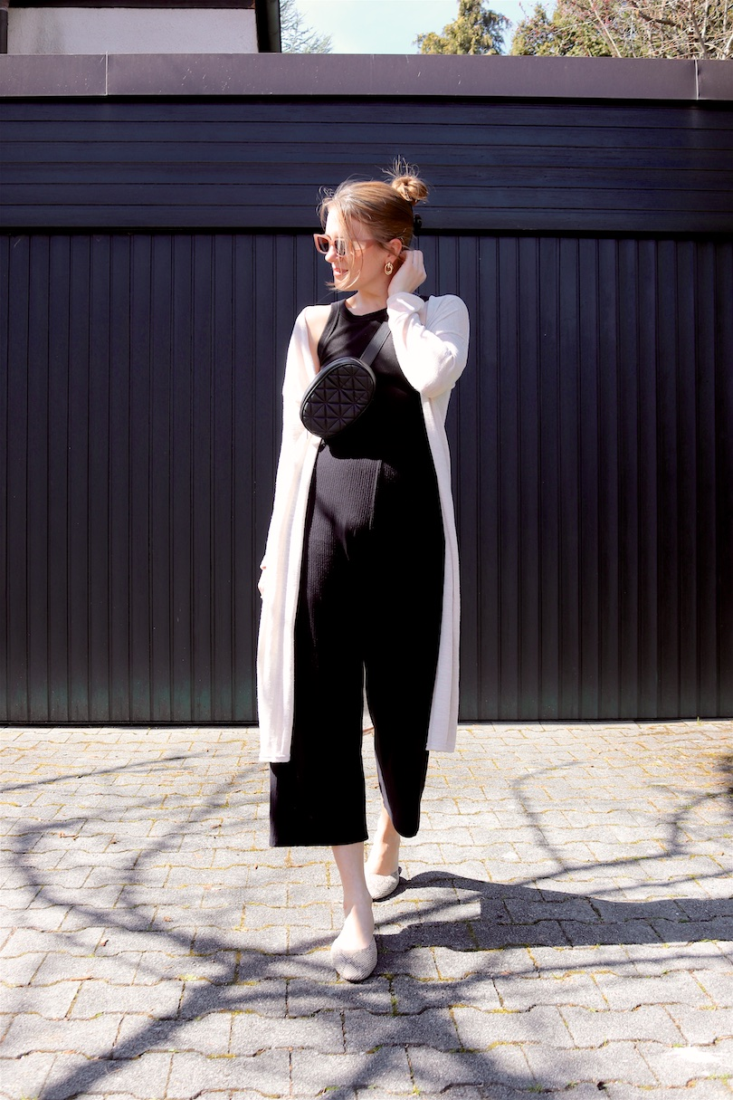 Black Spring Love. Fashion and Style Blog Girl from Heartfelt Hunt. Girl with blonde hair with a hair claw clip wearing a long cardigan, black top, black culotte, slim sunglasses, belt bag and mules.