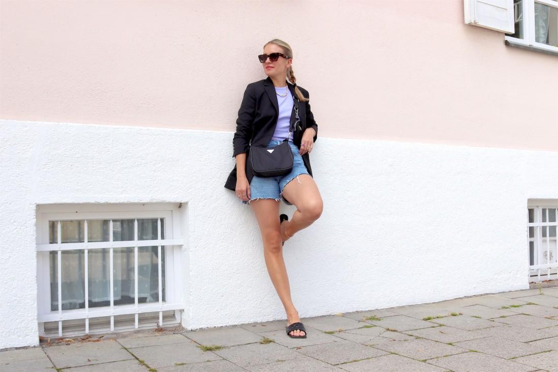 Blazer Denim Shorts. Fashion Blogger Girl by Style Blog Heartfelt Hunt. Girl with blond braid wearing a blazer, lilac top, denim shorts, edgy sunglasses, 90s bag and padded sandals.