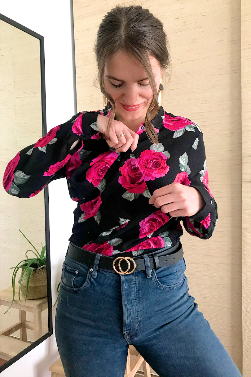 Blouse Fashion Hack. Fashion Blogger Girl by Style Blog Heartfelt Hunt. Girl with blond ponytail and pink scrunchie wearing a floral blouse, earrings, mom jeans and belt.