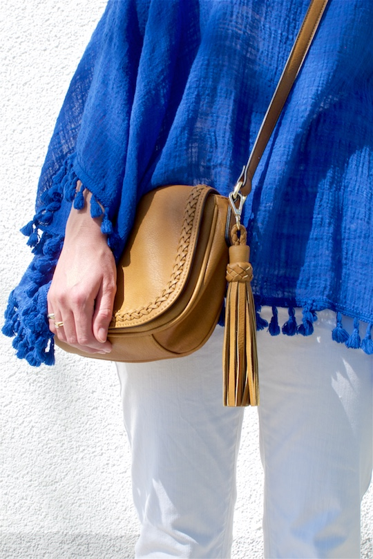 Blue Tassels. Fashion and Style Blog Girl from Heartfelt Hunt. Girl with two braids wearing a top with blue tassels, white jeans and bag with tassel.