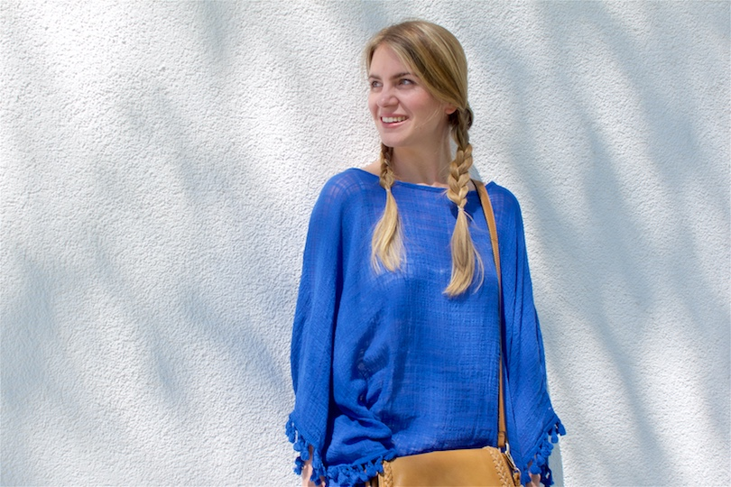 Blue Tassels. Fashion Blogger Girl by Style Blog Heartfelt Hunt. Girl with two braids wearing a top with blue tassels and bag with tassel.