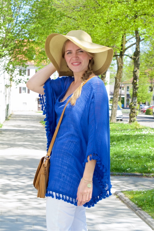 Blue Tassels. Fashion Blogger Girl by Style Blog Heartfelt Hunt. Girl with two braids wearing a top with blue tassels, white jeans, bag with tassel and a straw hat.
