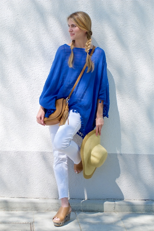 Blue Tassels. Fashion Blogger Girl by Style Blog Heartfelt Hunt. Girl with two braids wearing a top with blue tassels, white jeans, bag with tassel, wedges and a straw hat.