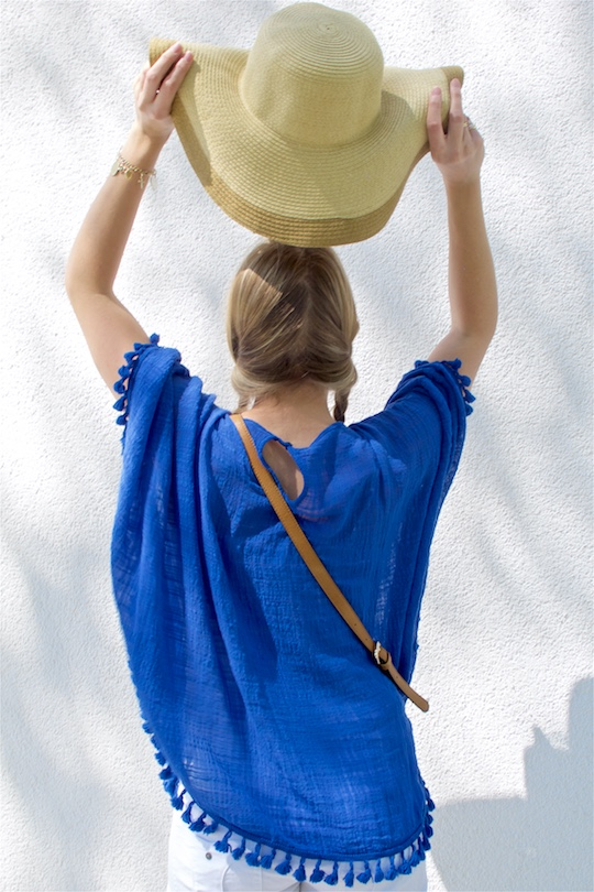 Blue Tassels. Fashion Blogger Girl by Style Blog Heartfelt Hunt. Girl with two braids wearing a top with blue tassels, bag with tassel and a straw hat.