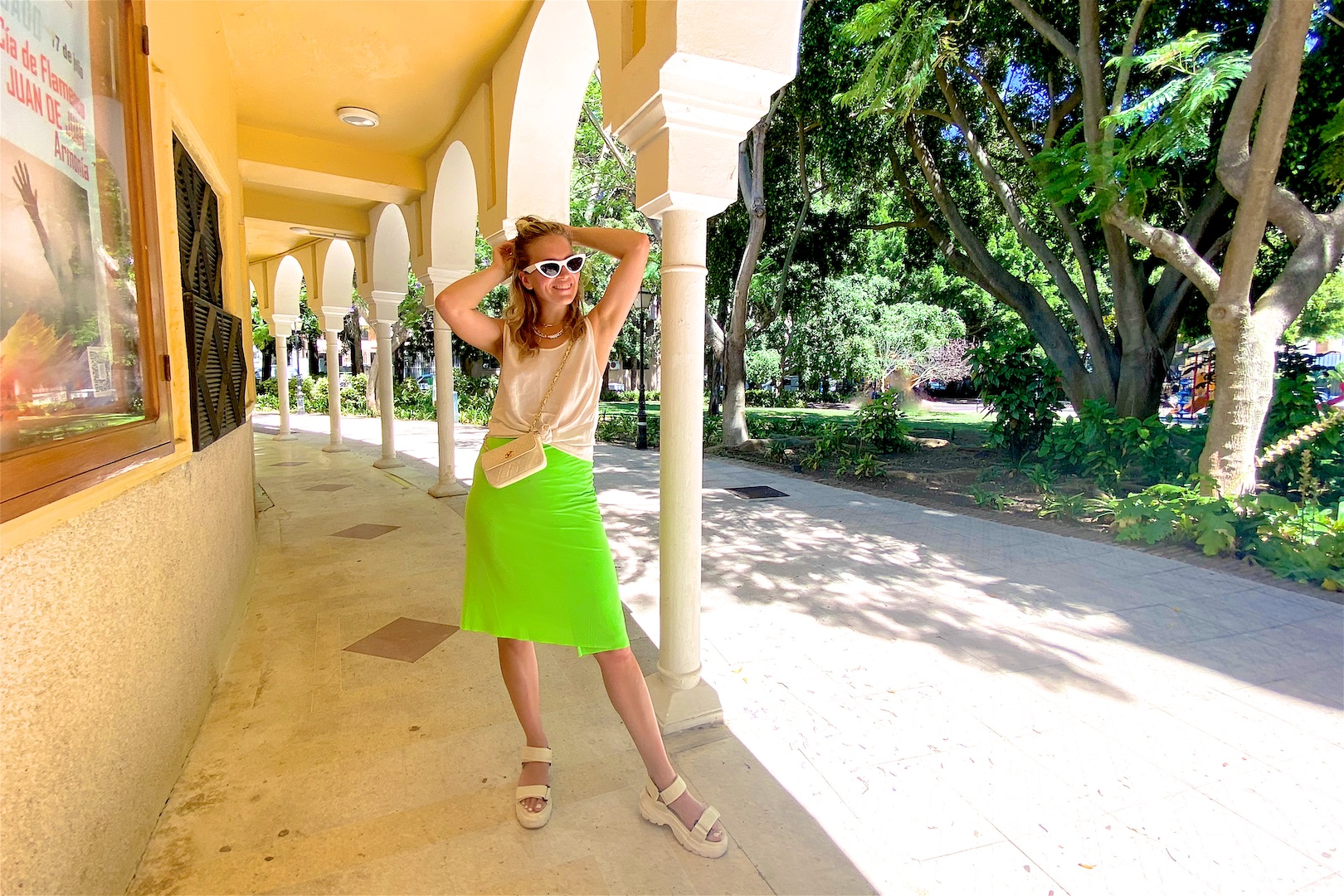 Botanical Garden. Fashion Blogger Girl by Style Blog Heartfelt Hunt. Girl with blond hair wearing a satin top, neon green pareo, white sunglasses, vintage chanel bag and chunky sandals.