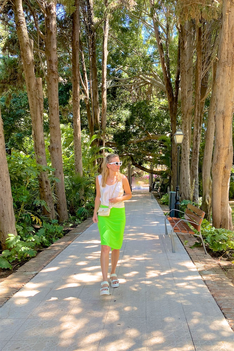 Botanical Garden. Fashion and Style Blog Girl from Heartfelt Hunt. Girl with blonde hair wearing a satin top, neon green pareo, white sunglasses, vintage chanel bag and chunky sandals.