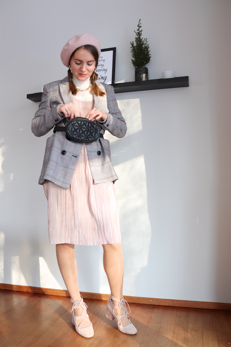 Braid Secret. Fashion Blogger Girl by Style Blog Heartfelt Hunt. Girl with blond bubble braids wearing a pink beret, statement necklace, belt bag, turtleneck, pleated dress, checked blazer and lace up shoes.