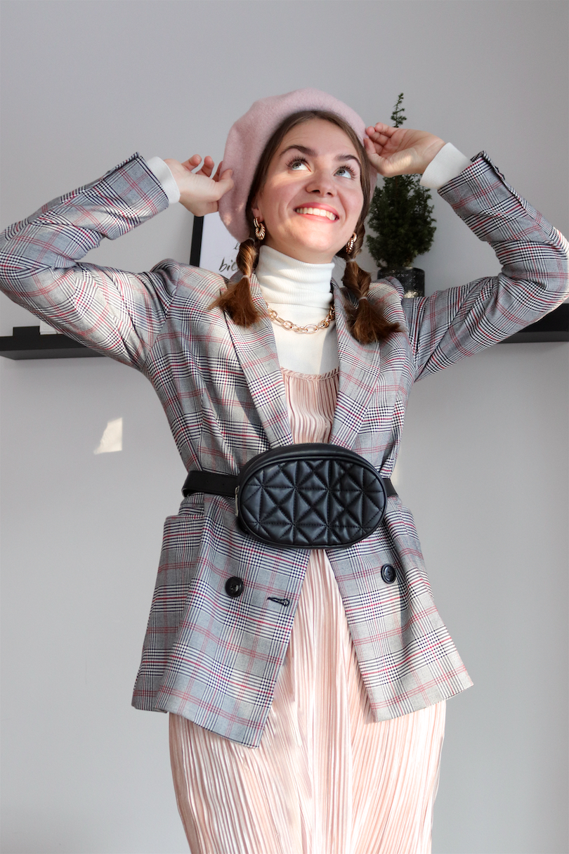 Braid Secret. Fashion and Style Blog Girl from Heartfelt Hunt. Girl with blonde bubble braids wearing a pink beret, statement necklace, belt bag, turtleneck, pleated dress, checked blazer and lace up shoes.
