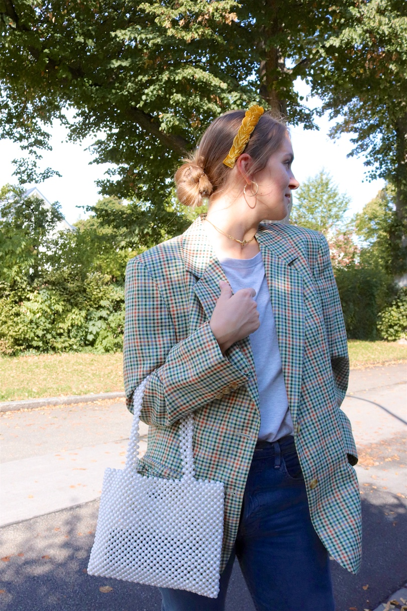Braided Headband. Fashion Blogger Girl by Style Blog Heartfelt Hunt. Girl with blond, low bun and a braided headband wearing golden earrings, checked blazer, gray T-shirt, mom jeans, pearl bag and chunky sneakers.