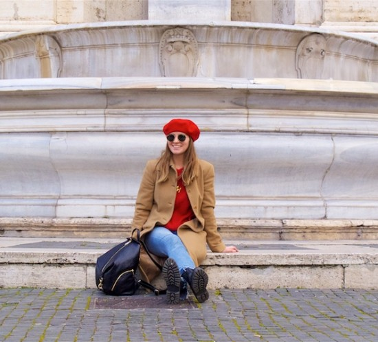 Camel Red. Fashion Blogger Girl by Style Blog Heartfelt Hunt. Girl with blond hair wearing a red beret, red sweater, camel coat, mom jeans, Rebecca Minkof backpack and chelsea boots.