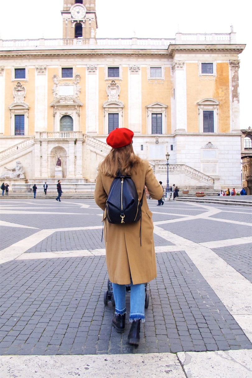 Camel Red. Fashion and Style Blog Girl from Heartfelt Hunt. Girl with blonde hair wearing a red beret, red sweater, camel coat, mom jeans, Rebecca Minkof backpack and chelsea boots.