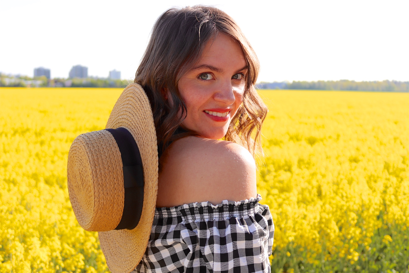 Canola Love. Fashion Blogger Girl by Style Blog Heartfelt Hunt. Girl with blond beach waves wearing an off-shoulder gingham blouse, black culotte, straw hat and straw bag.