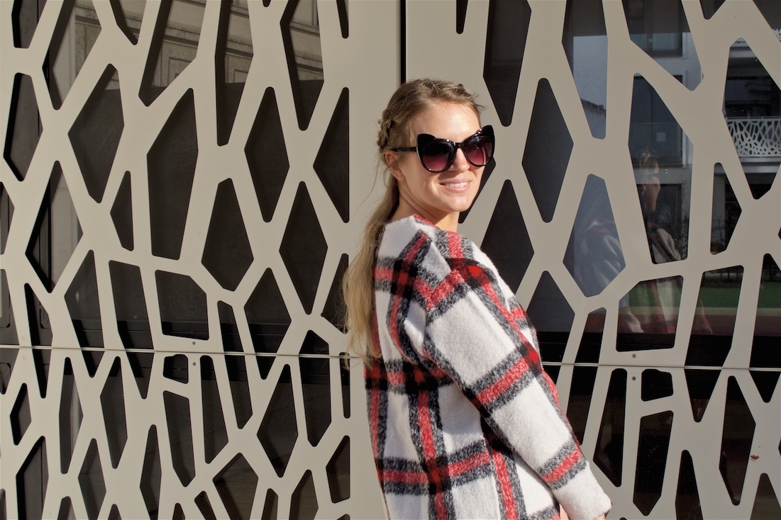 Casual Plaid. Fashion Blogger Girl by Style Blog Heartfelt Hunt. Girl with blond half-up half-down dutch braids wearing a casual plaid sweater, jeans, cat-eye sunglasses, backpack and adidas sneakers.