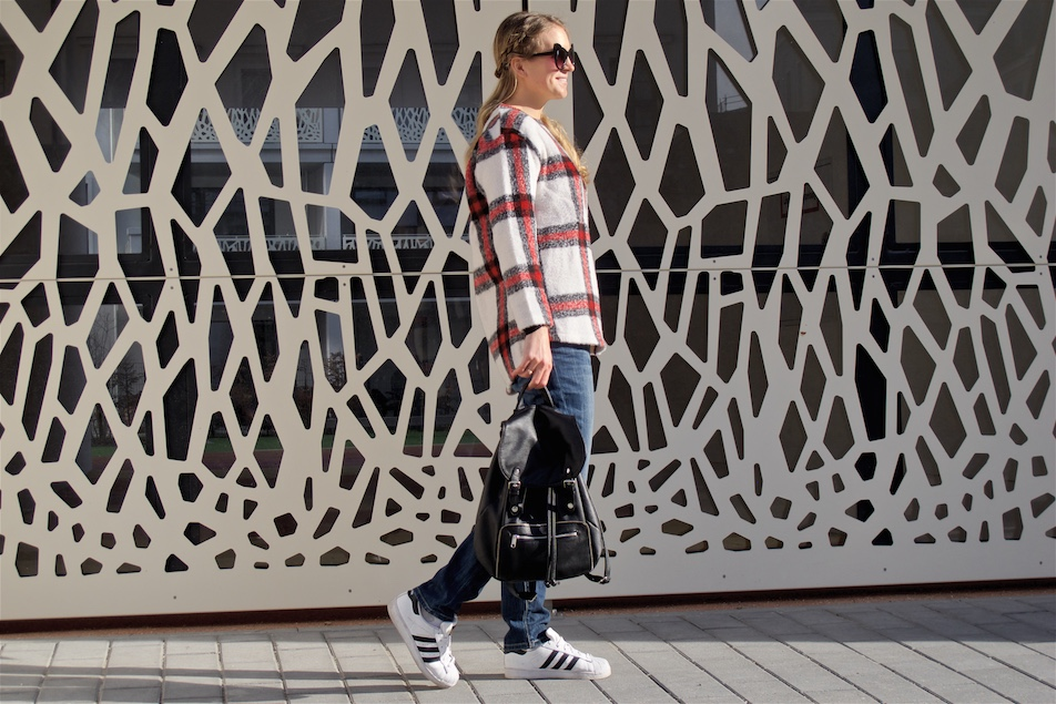 Casual Plaid. Fashion and Style Blog Girl from Heartfelt Hunt. Girl with blonde half-up half-down dutch braids wearing a casual plaid sweater, jeans, cat-eye sunglasses, backpack and adidas sneakers.