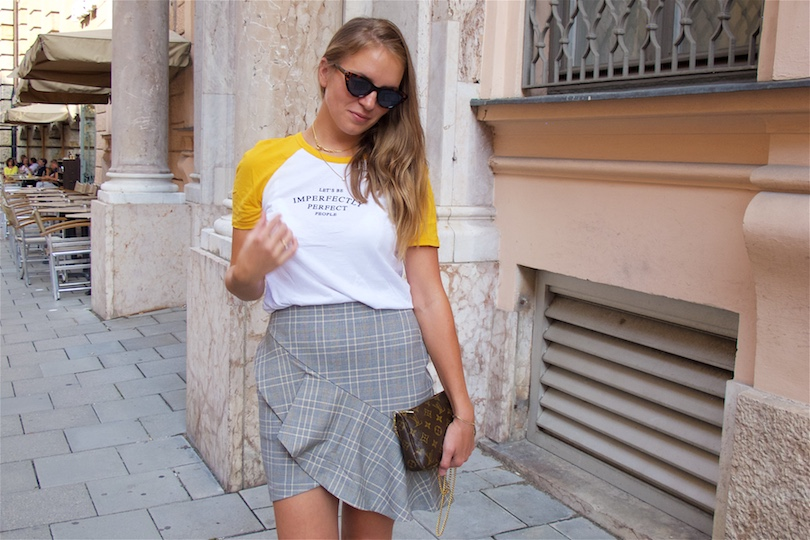 Checked Ruffled Skirt. Fashion Blogger Girl by Style Blog Heartfelt Hunt. Girl with blond hair wearing a checked ruffled skirt, t-shirt, Louis Vuitton bag, sunglasses and mules with pearls.