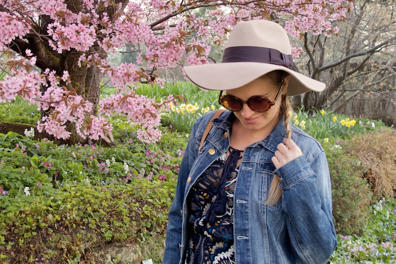 Cherry Blossom. Fashion and Style Blog Girl from Heartfelt Hunt. Girl with blonde dutch side braid wearing a flower dress, denim jacket, floppy hat, tassel bag and boots.