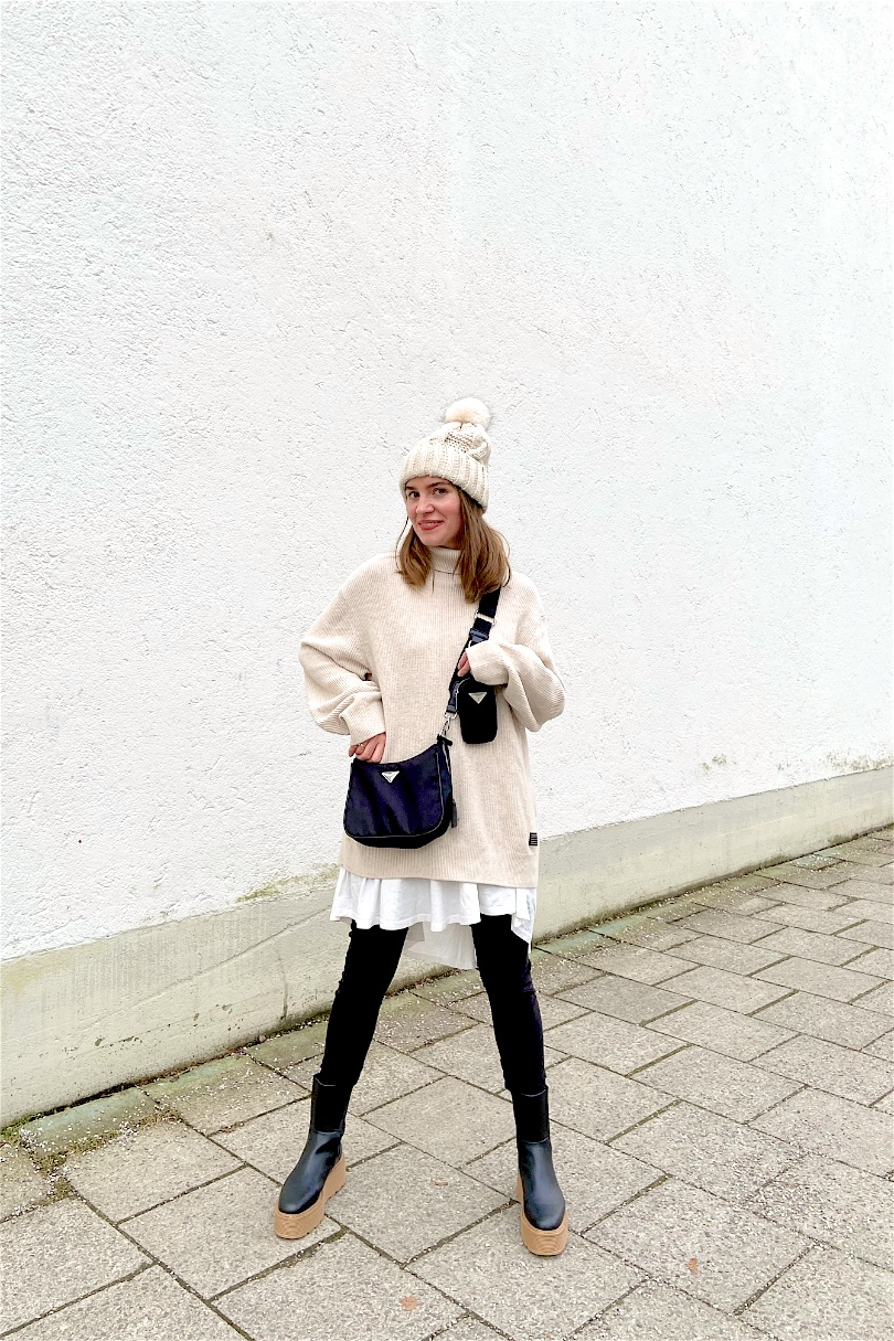 Chunky Chelsea Boots. Fashion and Style Blog Girl from Heartfelt Hunt. Girl with blonde hair wearing a turtleneck sweater, faux leather leggings, pompom beanie, 90s bag and chunky chelsea boots.