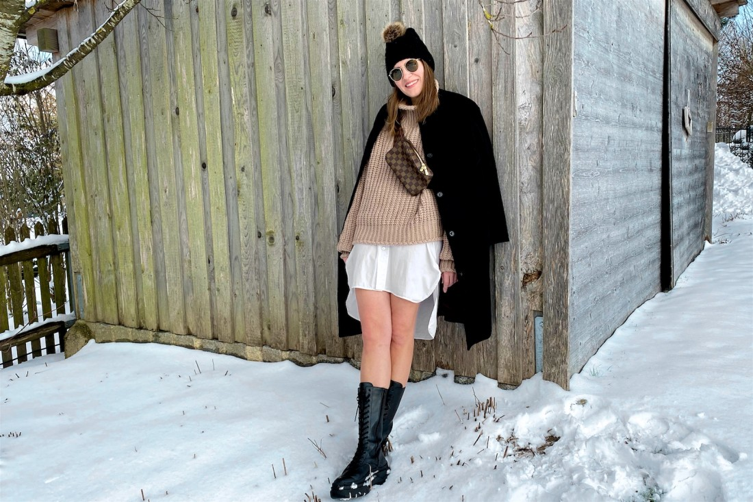 Combat Boots. Fashion Blogger Girl by Style Blog Heartfelt Hunt. Girl with blond hair wearing a black coat, turtleneck sweater, long blouse, pompom beanie, Louis Vuitton belt bag and combat boots.