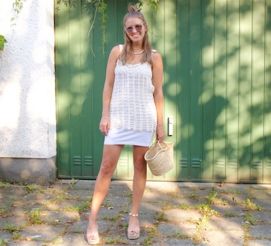 Crochet Top. Fashion Blogger Girl by Style Blog Heartfelt Hunt. Girl with blond half-up half-down hairstyle wearing a crochet top, white dress, sunglasses, straw bag and raffia heels.