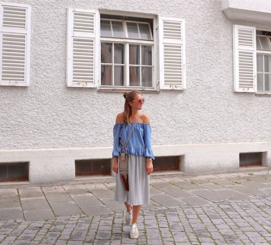 Denim Off Shoulder. Fashion Blogger Girl by Style Blog Heartfelt Hunt. Girl with blond half-up half-down messy bun wearing a denim off shoulder top, pleated skirt, nude sunglasses, Chloé bag and adidas sneakers.